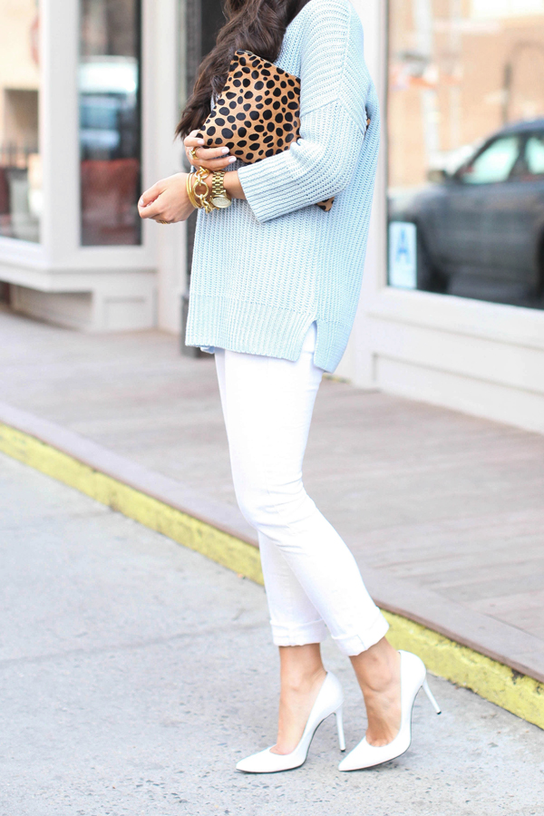 With Loves From Kat Wearing Pastel Blue Top From Theory, White James Boyfriend Jeans, Stuart Weitzman Shoes, And Clare Vivier Clutch