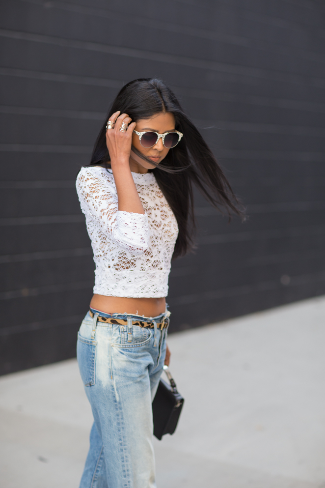 Walk In Wonderland Wearing Lace Top And Jeans From Calvin Rucker, Bag And Belt From B-low the Belt, Shoes From Chelsea Paris, And Sunglasses From Quay Australia