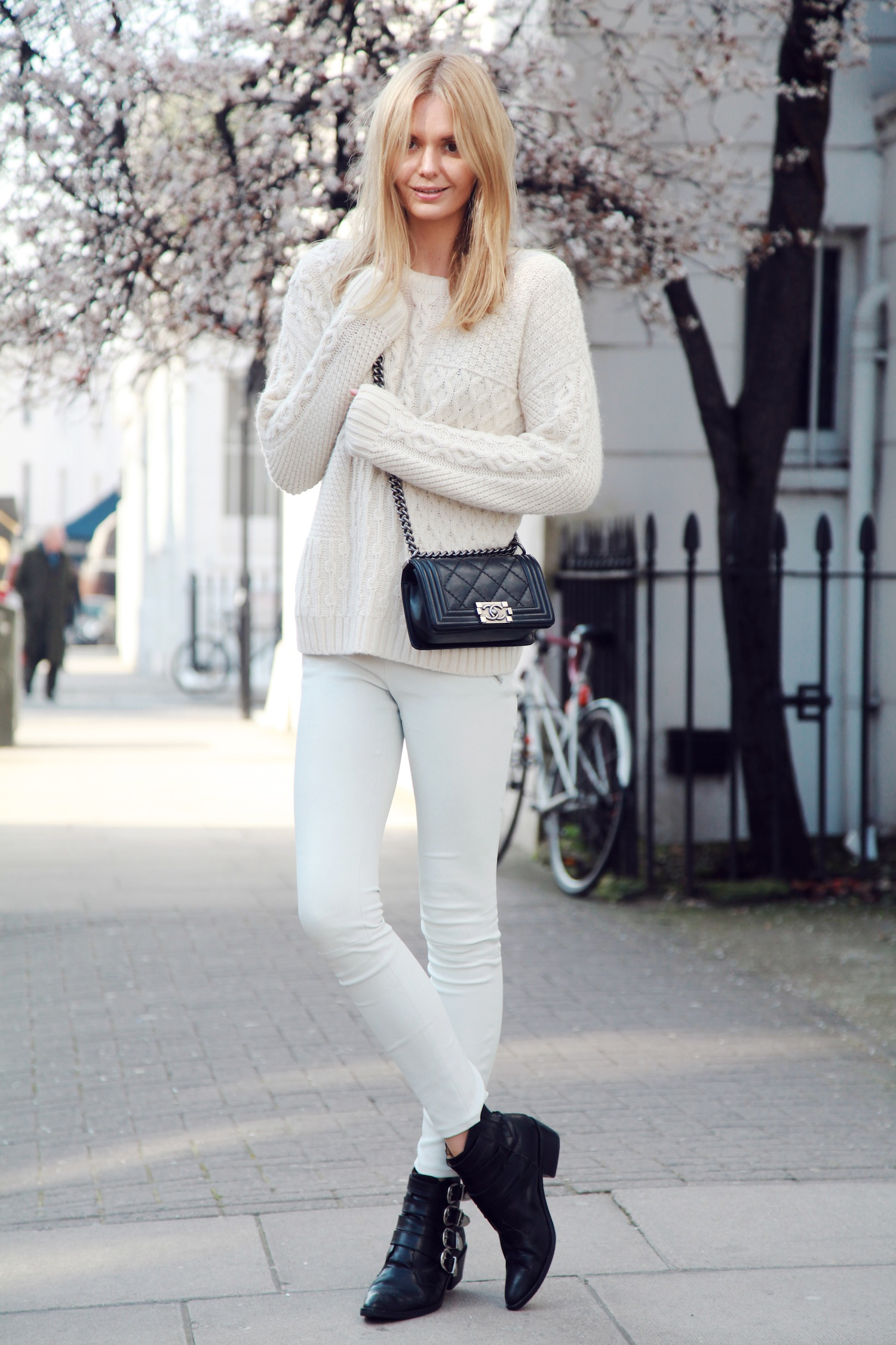 Tuula Vintage Wearing Top From Topshop Knit, Leather Pants From J Brand, Boots From Toga and Bag From Chanel