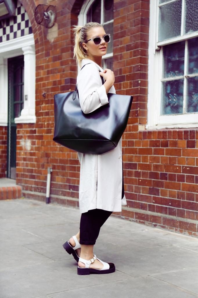 Isabella Thordsen Is Wearing Bag From Givenchy, Sandals, T-shirt And Sunnies From Asos, And Trousers From LOVE