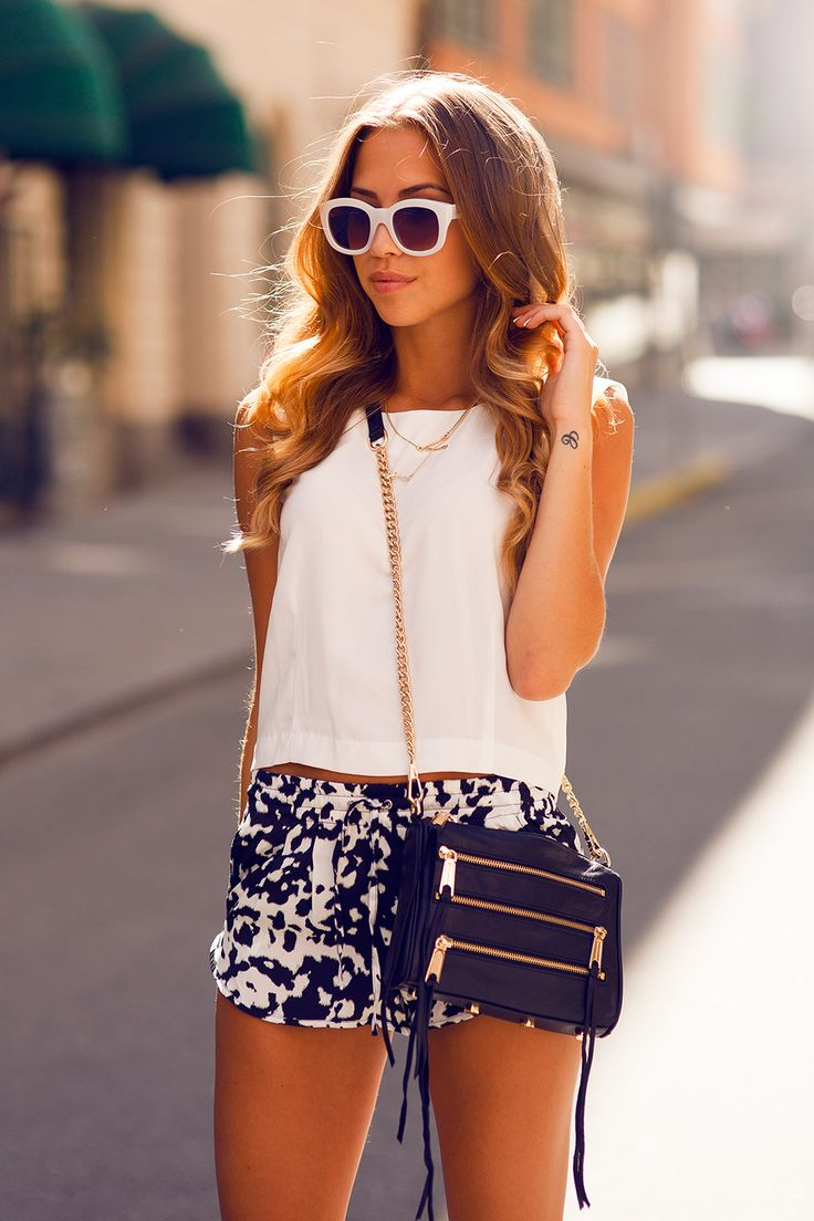 Kenza Zouiten is Wearing Shorts From Bershka, Top From Issue 1.3, Sunglasses From Le Specs And Bag From Rebecca Minkoff