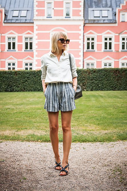 Charlotte Hellberg is wearing striped shorts and bag from Zara, linen shirt and sandals from & Other Stories and sunglasses from Karen Walker