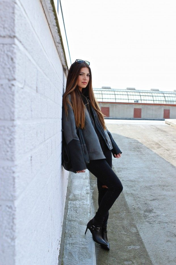 Negin Mirsalehi Wearing Leather Moto Jacket, River Island Jeans, Saint Laurent Boots