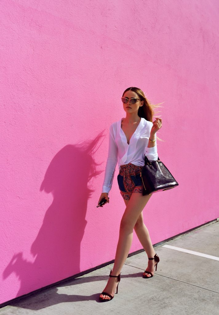 Kayture Is Wearing Top By Zara, Shorts By Tolani Bag, Louis Vuitton Shoes