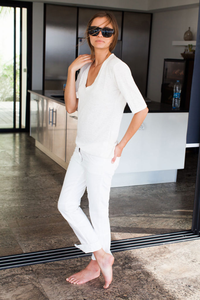 Fashion Blogger Doina Ciobanu Wearing Emerson Fry Top And White Trousers