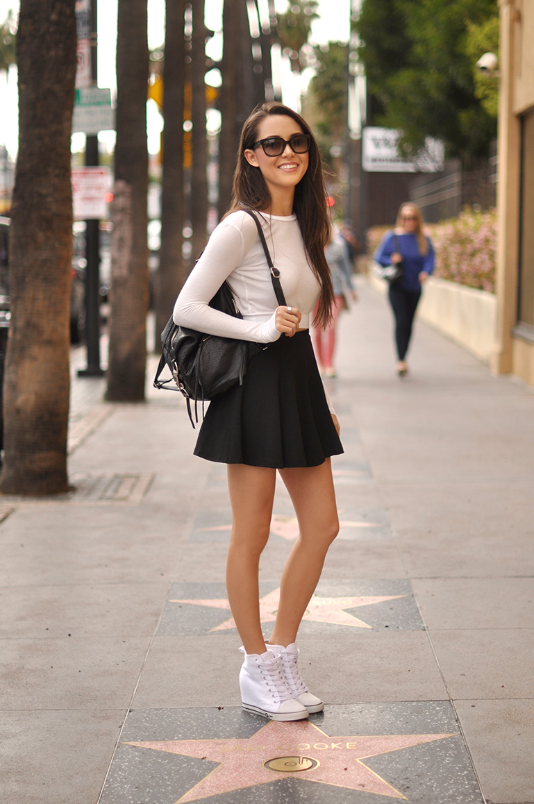"HapaTime Is Wearing Top From Revolve A Romwe skirt , Guess ""Majestey"" sneakers And A Rebecca Minkoff backpack"