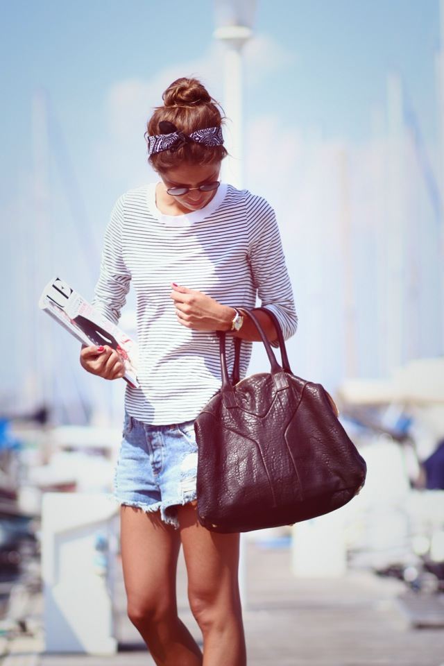 Arty Filles Wearing Striped Top From COS – Shorts From Pull&Bear, Sunglasses From Ray-Ban And Bag From Yves Saint Laurent
