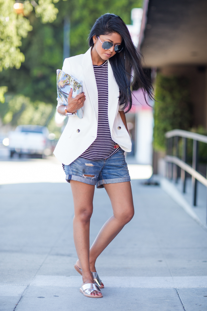 Sheryl Luke is wearing a striped top from Halston, denim shorts from Rag & Bone, white blazer from French Connection and silver shoes from Jeffrey Campbell