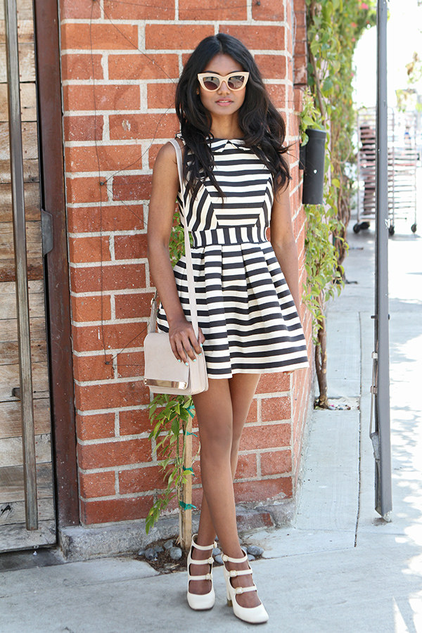 Tiffany Borland Is Wearing A Striped Dress From ASOS, Purse From ASOS And Gold Tipped Shoes From Chloe