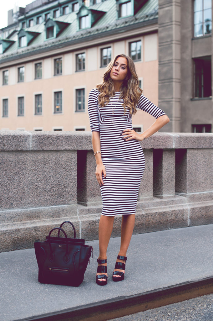 Kenza Zouiten is wearing a striped dress and shoes from Zara and a bag from Celine