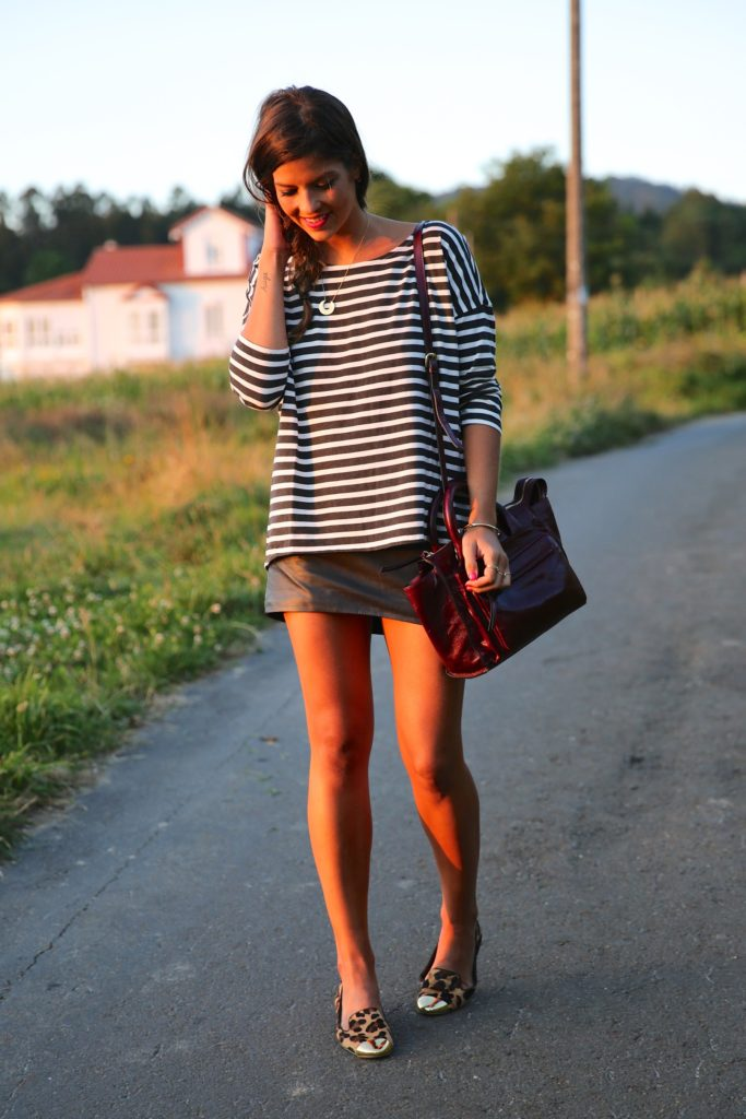 Natalia Cabezas is wearing a striped wide neck top by Dr Denim, skirt from Chic Place and shoes from Jessica Simpson