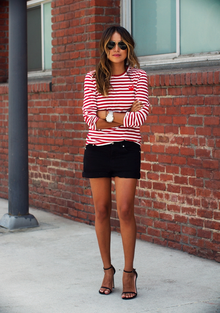 Julie Sarinana is wearing a red and white red striped top from Cpmme Des Garcon, black denim boyfriend shorts from Madewell and the shoes are from Stuart Weitzman