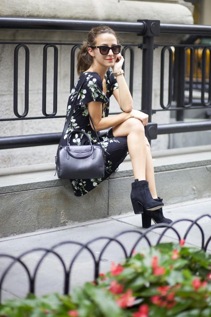 Arielle Nachmani is wearing a dark floral dress from Planet Blu, boots from French Connection, bag from Reece Hudson and sunglasses from Anine Bing