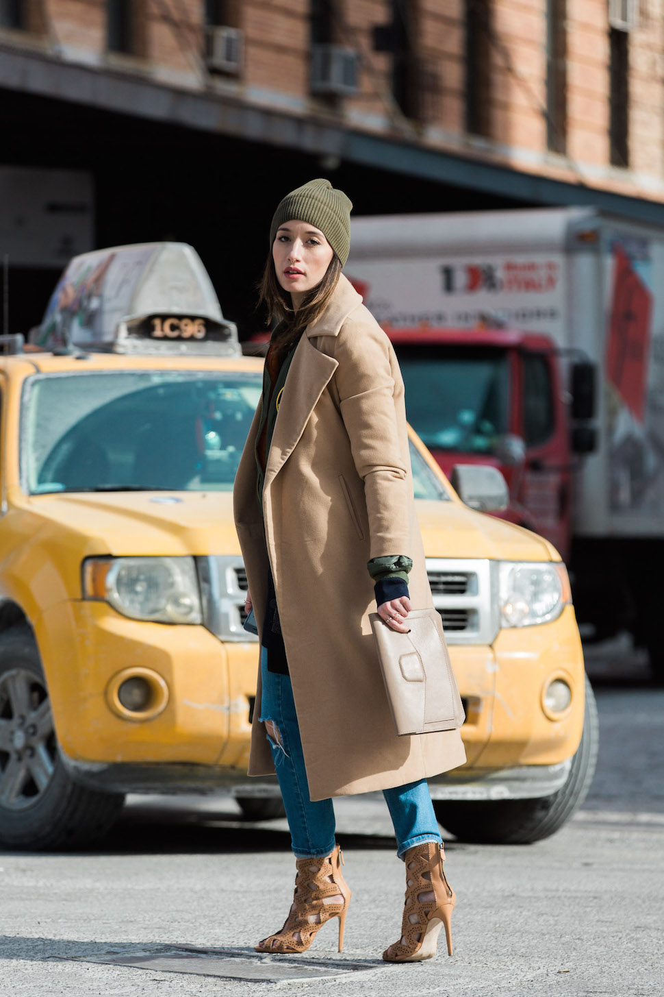 Alexandra Guerain is wearing a classic Miss Guided camel coat