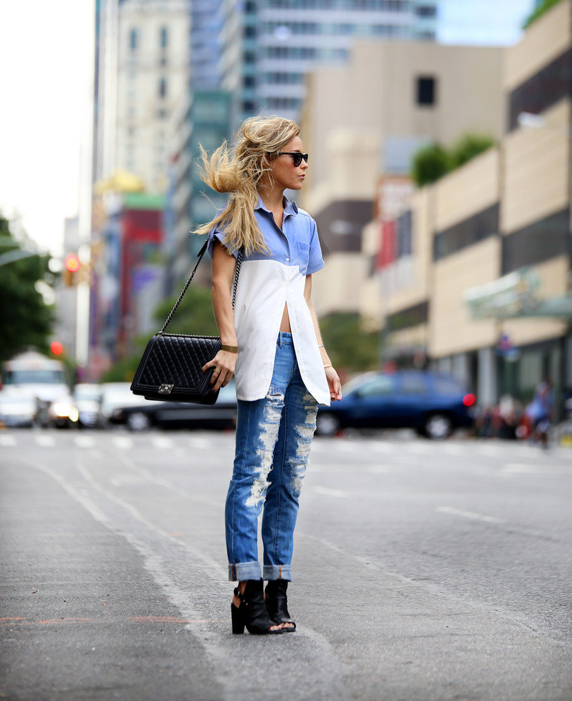 Mary Seng is wearing a blue and white shirt from Wren, distressed jeans from Blank NYC, sandals from Rag & Bone and the bag is from Chanel