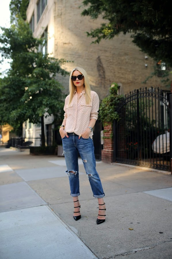 Blair Eadie is wearing a top from Equipment, ripped jeans from Current Elliott, shoes from Gianvito Rossi and sunglasses from Valentino