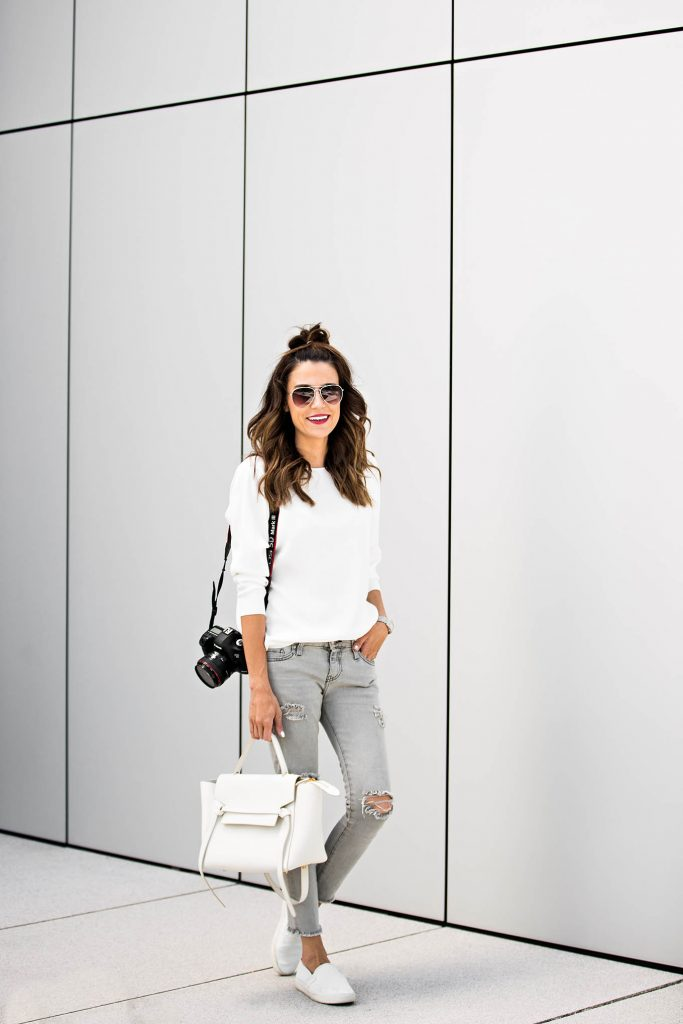 Christine Andrew keeps it simple here, in a pair of distressed denim skinnies paired with a long sleeved white tee for a classic fall style. Throw on a pair of white canvas shoes to get this cool and casual aesthetic! Outfit: Nordstrom.