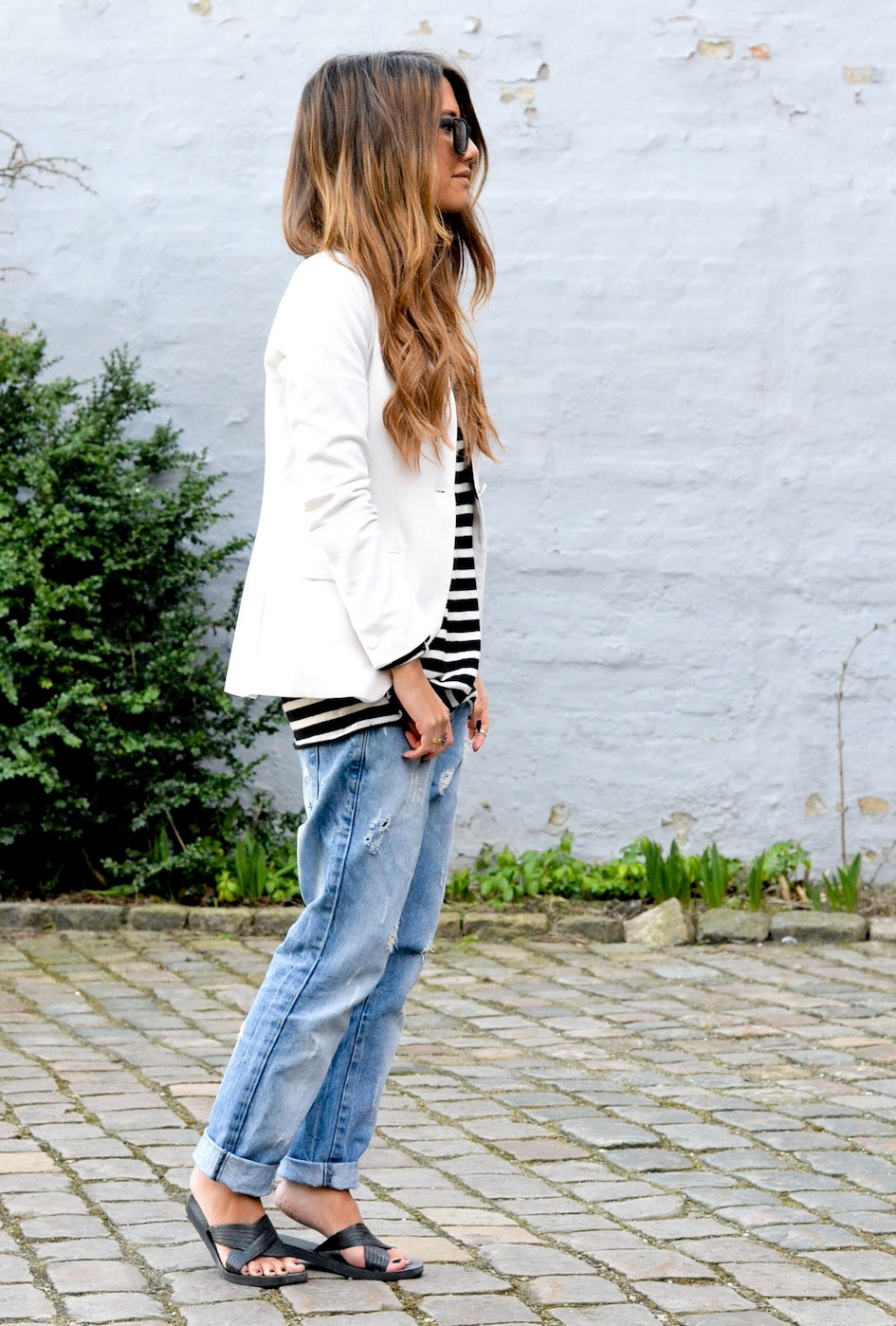 Stone Muse Is Wearing H&M Striped Top And White Blazer From H&M And Distressed Secondhand Jeans