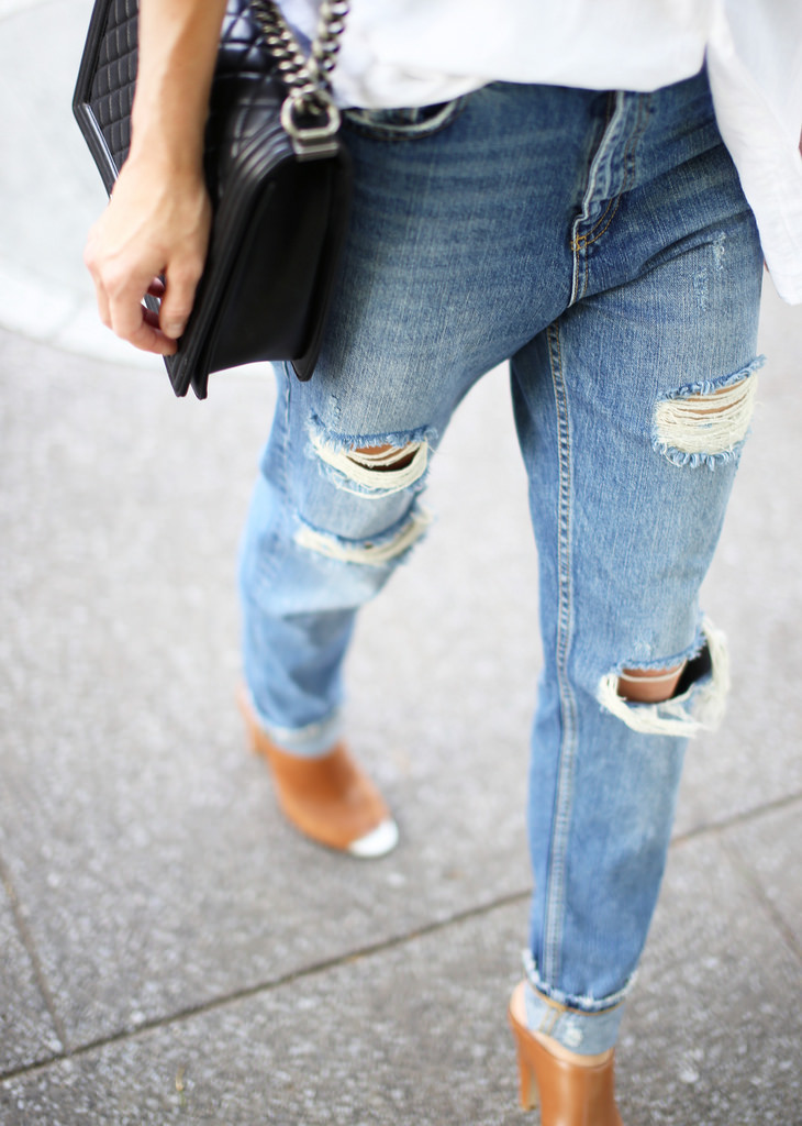 Mary Seng Is Wearing A Ripped Jeans From Zara, Shoes From French Connection, Bag From Chanel