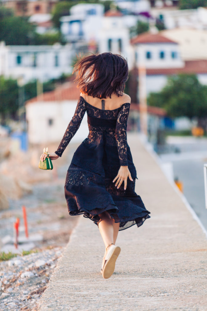 Doina Ciobanu is wearing a black lace dress from Rhea Costa and a green clutch from Bochic