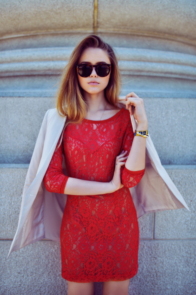 Kristina Bazan is wearing a red lace dress from Guess, blazer from Minusey and sunglasses from Céline