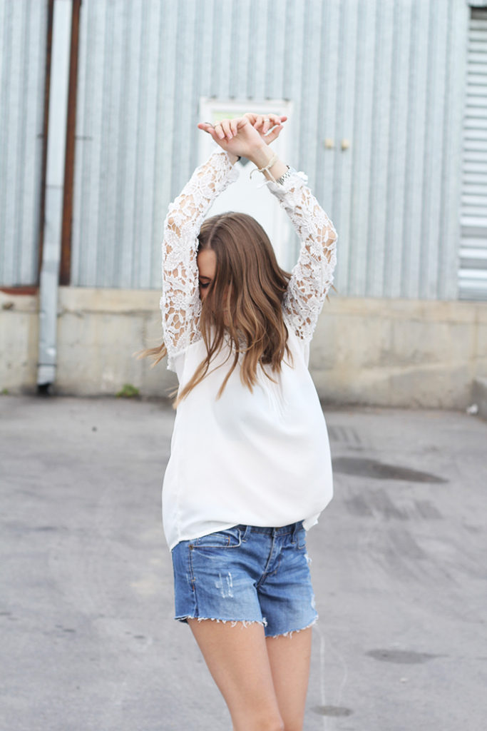 Vanja Milicevic is wearing a white lace top from Sheinside and shorts from Primark