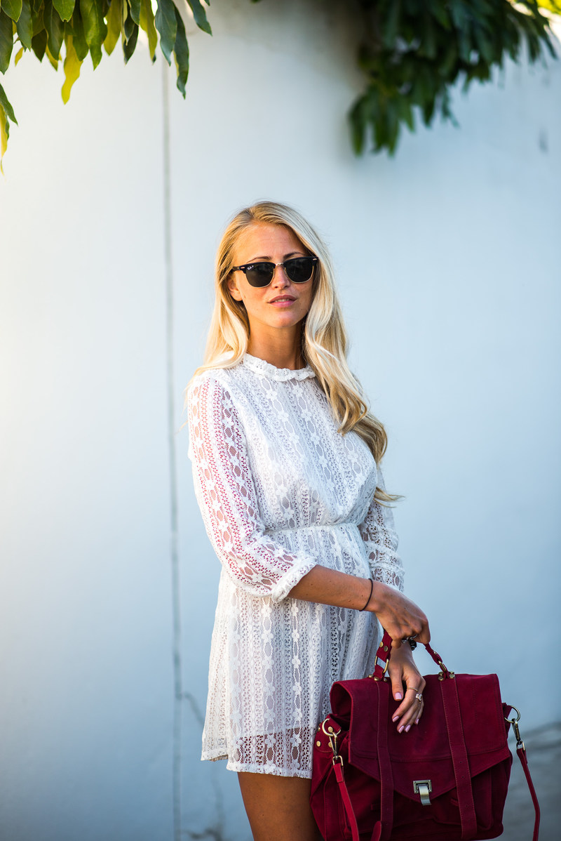 Janni Deler is wearing a white lace from Sanne Alexandra, bag from Chicwish and sunglasses from Rayban