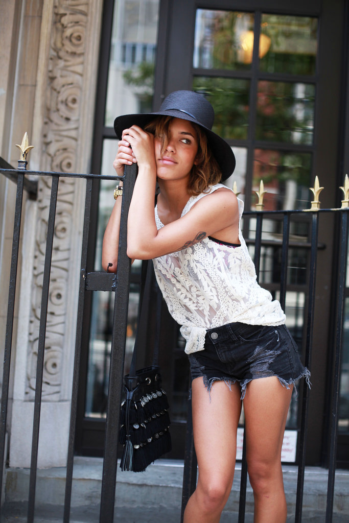 Christina Caradona is wearing lace top and shorts from Express, hat from Worth And Worth and the bag is from Stela 9