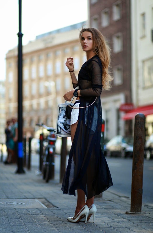 Juliett Kuczynska is wearing a lace blouse dress from UEG, shoes from Kazar and the bag is from Guess
