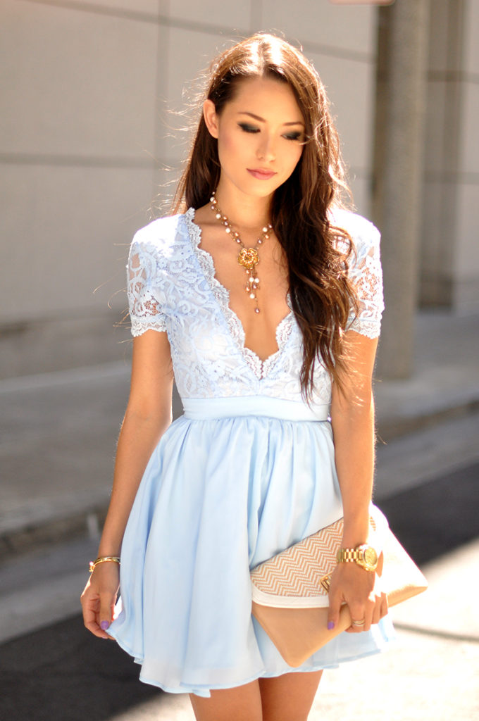 Jessica R. is wearing a light blue laced dress and clutch from Aldo