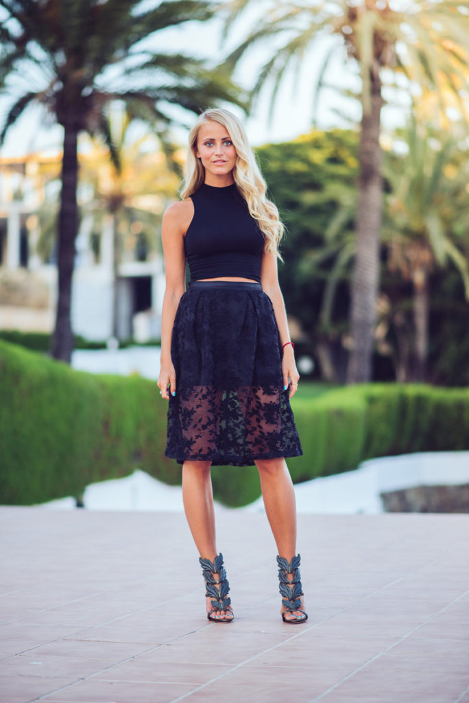 Janni Deler is wearing a top from Bershka, black mesh embroidered floral skirt from Choies and Giuseppe Zanotti