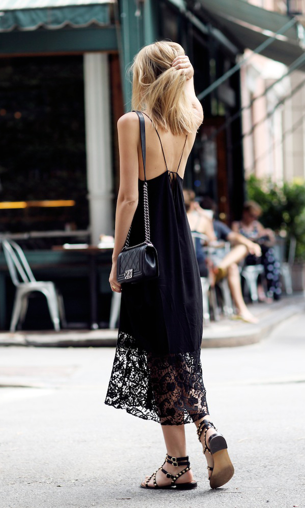 Jessica Stein is wearing a lace maxi dress from Sam & Levi, bag from Chanel and studded sandals from Sam Edelman