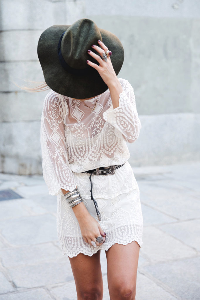 Sara Escudero is wearing a white vintage lace dress and a hat from Zara