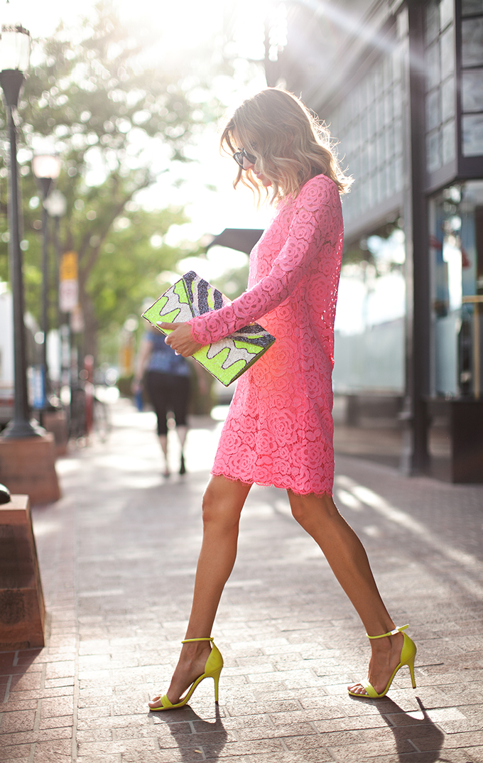 Christine Andrew is wearing a pink lace dress from DKNY, shoes from Prabal Guru and a neon clutch from Nila Anth