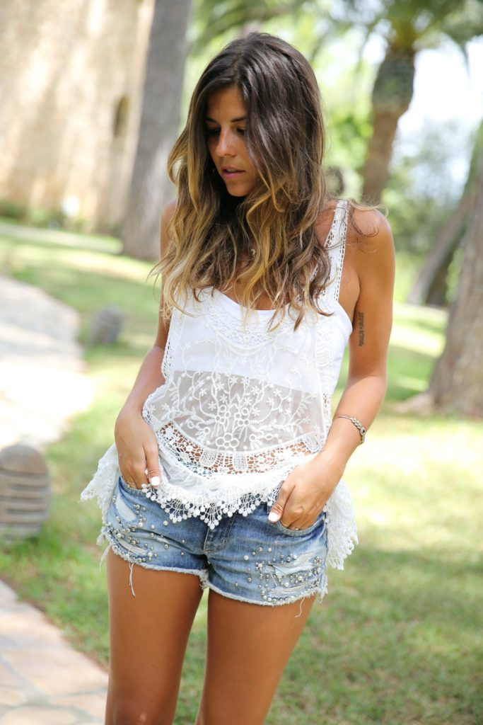 Natalia Cabezas is wearing white lace from the Ibiza Hippie Market and denim shorts from Coosy