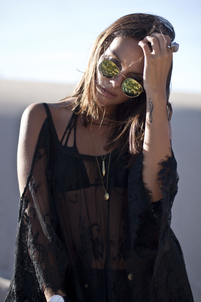 Mafalda Castro is wearing a black lace dress from Sheinside and bikini top from Billabong