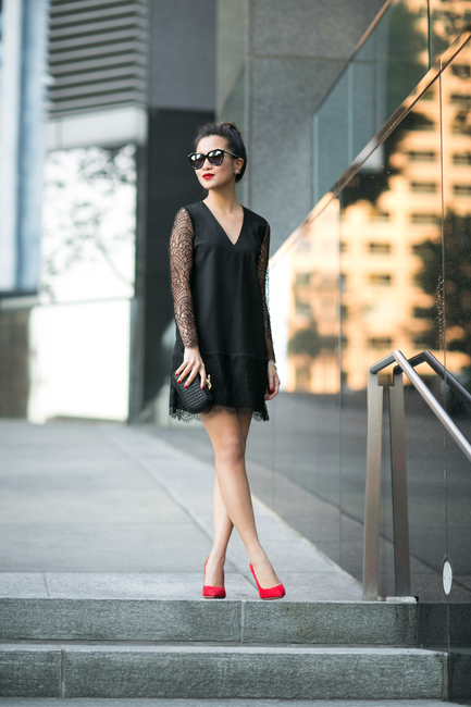 Wendy Nguyen is wearing a black lace dress from Marissa Webb, shoes from Charlotte Olympia, bag from DVF and sunglasses from Karen Walker