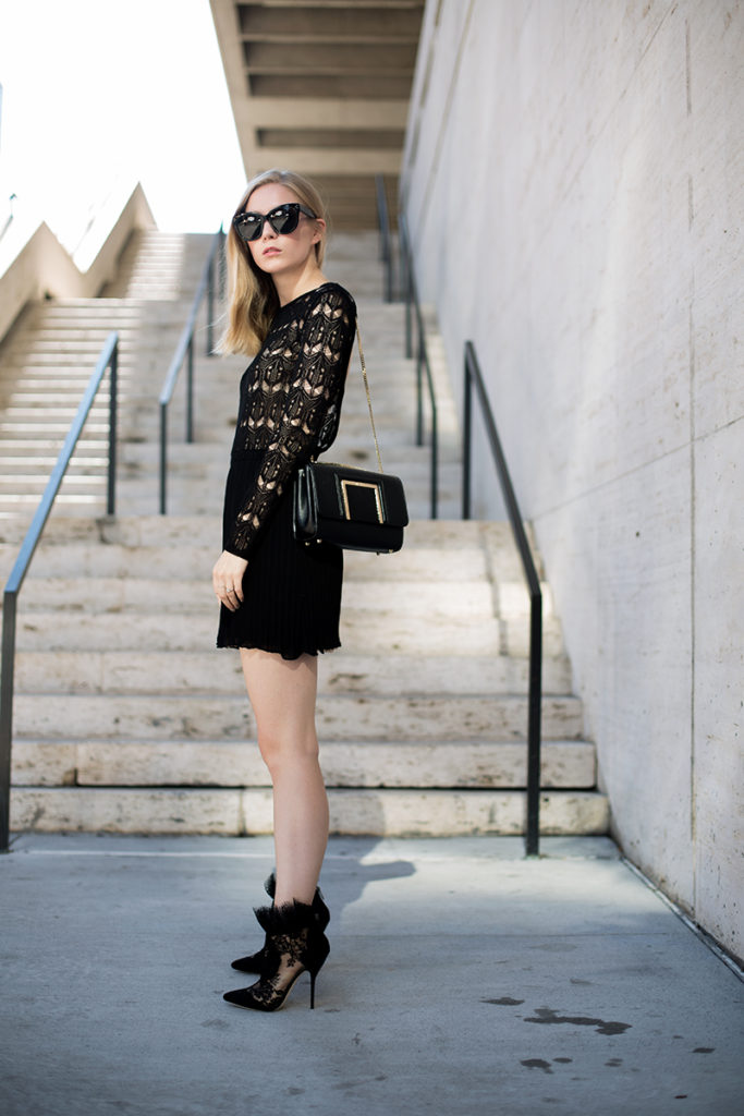 Carolina Engman is wearing a black lace dress from Dagmar, bag and shoes from Jimmy Choo and the sunglasses are from Céline