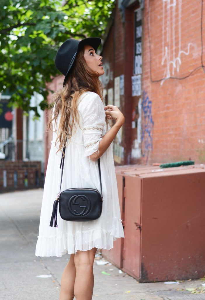 Stella Wants To Die is wearing a white lace dress from Free People, bag from Gucci and the hat is from Urban Outfitters