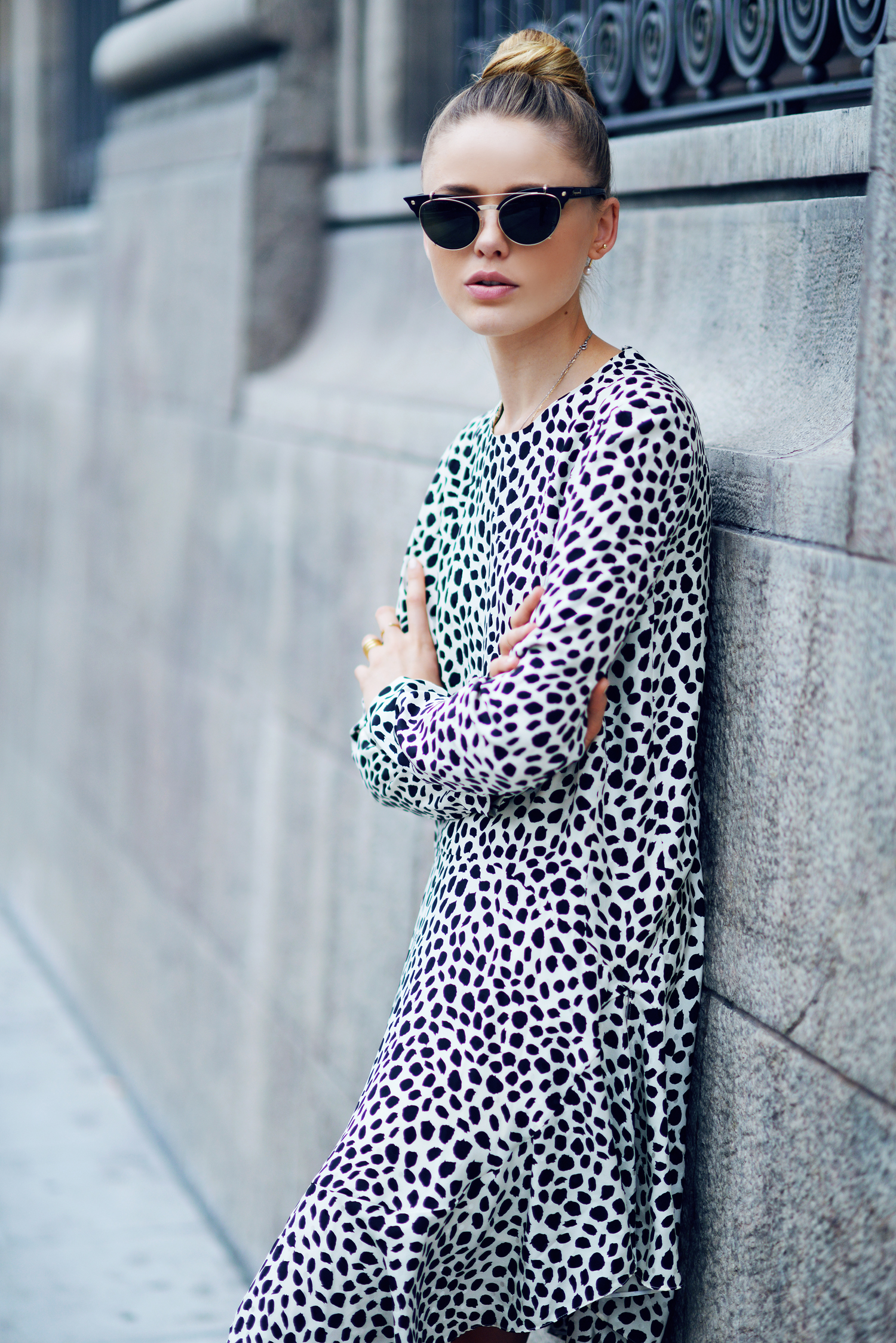 Kristina Bazan is wearing a leopard print dress from Chloe and sunglasses from D Squared