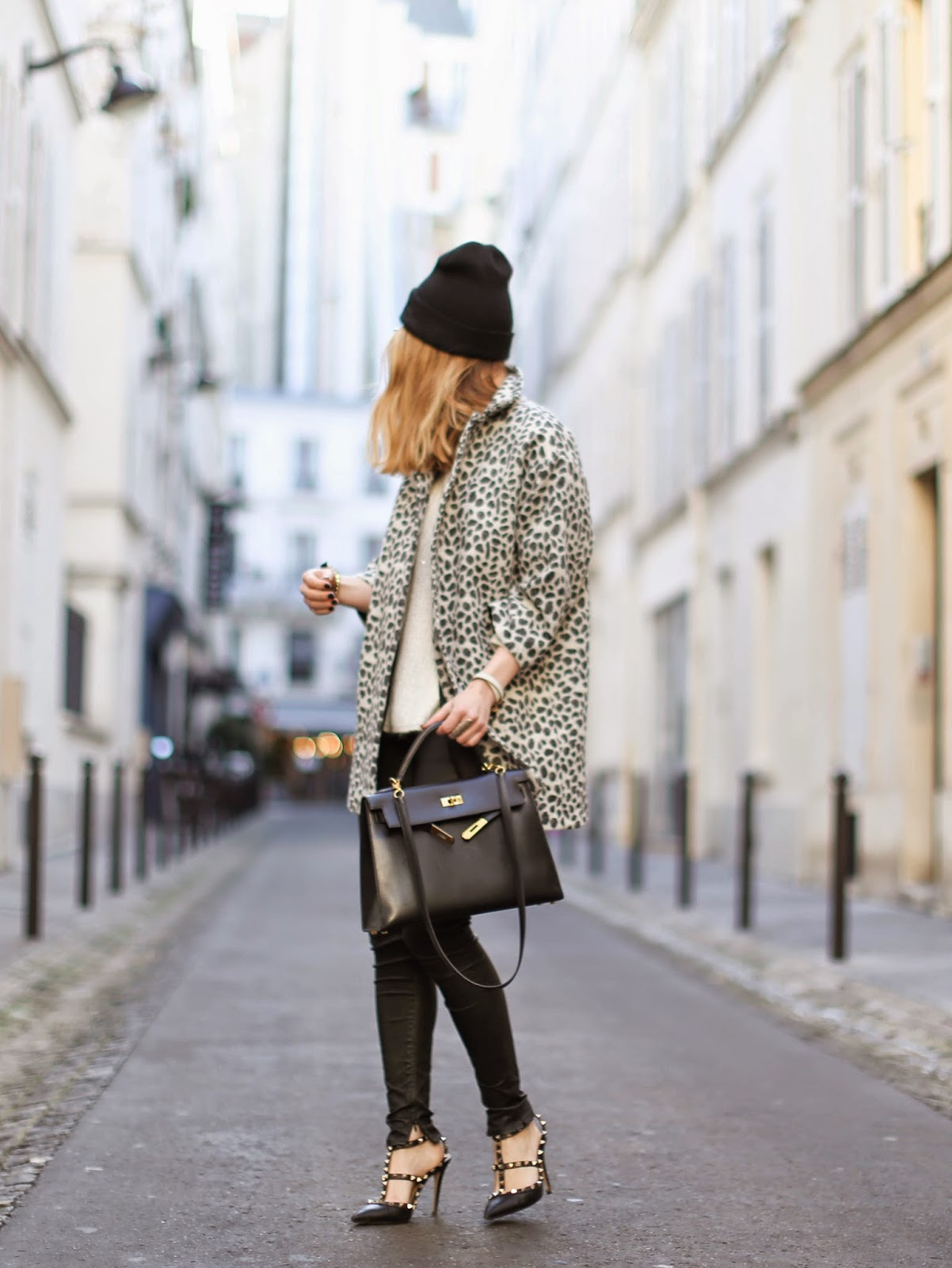 Caroline Louis is wearing a leopard print coat from Les Explorateurs