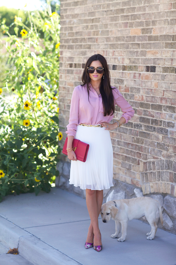 Rachel Parcell is wearing a peppermint top from J. Crew, white pleated skirt from TopShop, shoes from kate Spade, clutch from Saint Laurent, and sunglasses from Karen Walker