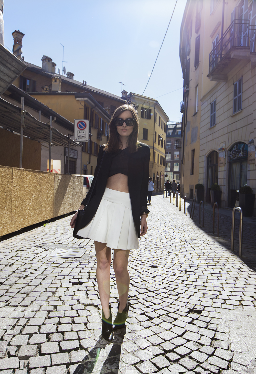Anouska Is Wearing Black Blazer By Beneton, White Pleated Skirt And Black Top From Jovonna, Boots From Sigerson Morrison And Sunglasses From Céline