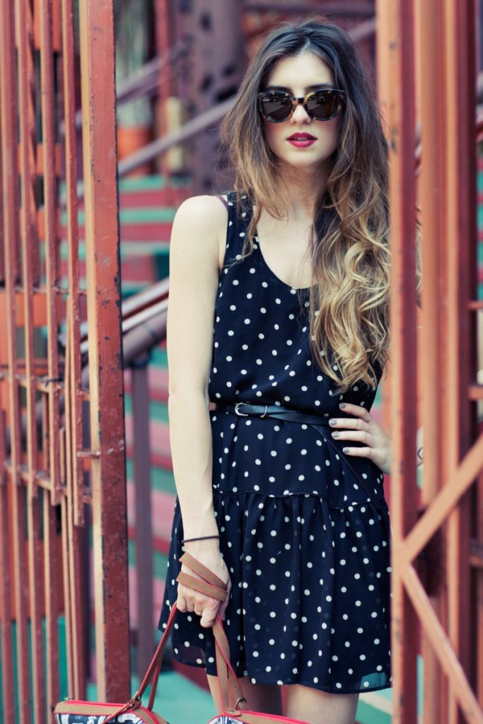 On The Racks Wearing Forever 21 Polka Dot Dress And SEE Sunglasses