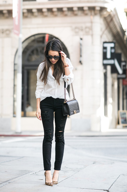 A monochrome look can be made even cooler by wearing a pair of ripped black jeans. Wendy Nguyen looks ultra edgy in this simplistic outfit, consisting of a white shirt, ripped jeans, and statement leopard print heels! Top: Nili Lotan, Jeans: Frame, Bag: Chanel, Shoes: Christian Louboutin.