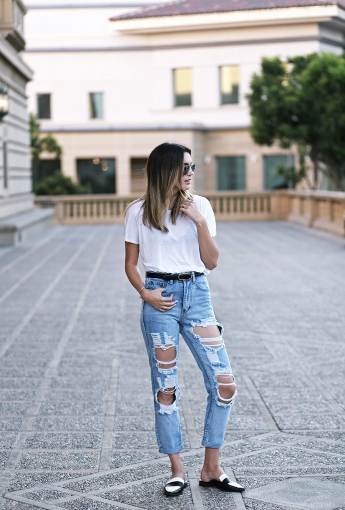 Ripped Jeans Outfits: It can't be much simpler. White semi see-through tee, ripped jeans and a pair of black and white loafers. Via Brittany Xavier  Shirt: Primary New York, Jeans: Boohoo, Bralette: Urban Outfitters, Shoes: Forever21