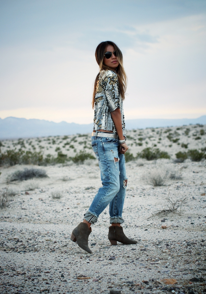 Julie Sarinana is wearing a sequin blouse from Missguided, jeans from Ralph Lauren, sequin belt and boots from H&M