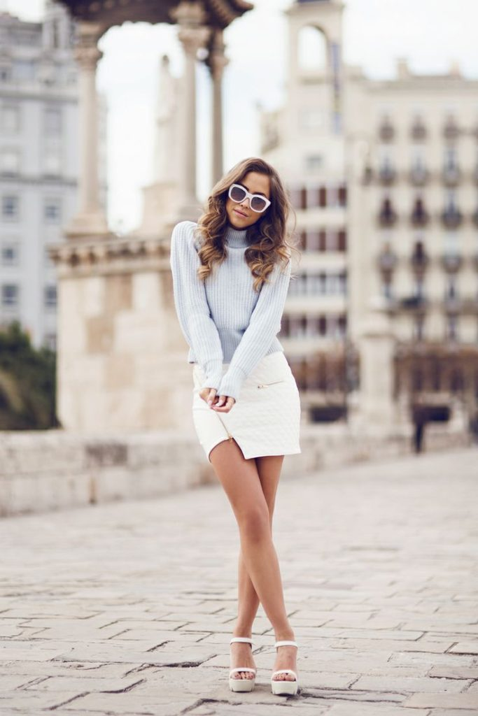 Kenza Is Wearing A White Skirt From Ivy Revel, Top From Acne, Shoes From Jennie-Ellen And Sunglasses From Le Specs