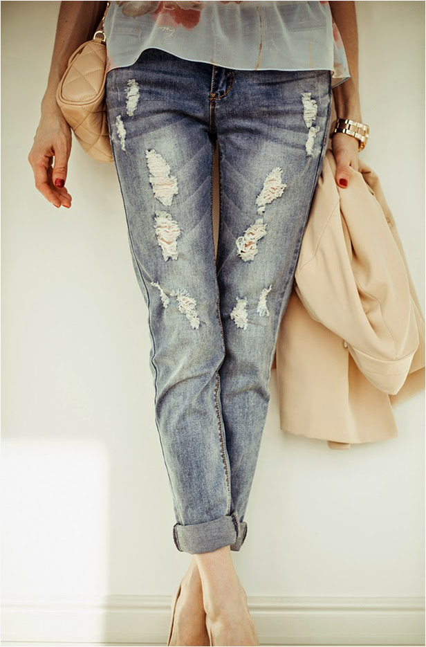 Tanya from Tini Tani is wearing distressed jeans from Be Free and Floral top designed by Tanya