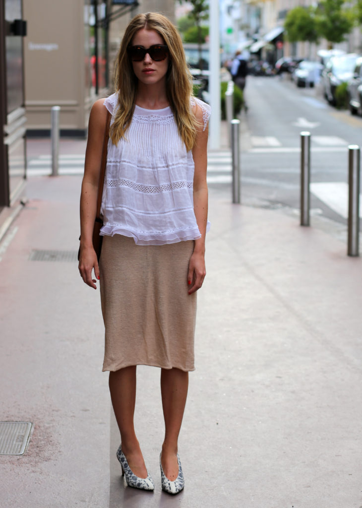 Annabel Rosendahl is wearing a white lace top from Isabel Marant, beige dress from Whyred and the bag is from Celine